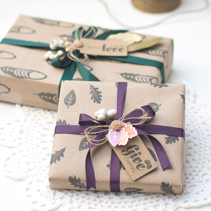 brown paper wrapping with black stamped designs in feather and leaf print